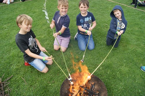 Toasting marshmallows at Sycamore Adventure Play