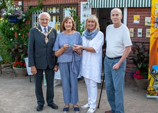 Friends of Huntingtree Park collecting the award