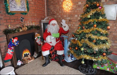 A picture of Santa at the Red House Glass Cone